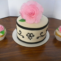 Romantic Rose   This was a white cake w/ a fondant rose on top. It had a dozen matching cupcakes as well!
