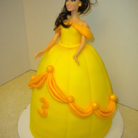 "Belle Disney's Beauty & The Beast  This was a white cake with strawberry creme filling. I used a 6"" round and the wilton sports ball pan. I then carved down the sides to..."