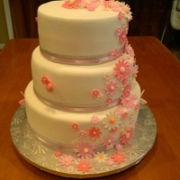 "Daisy Wedding Cake   White cake w/Fondant icing and Fondant accents. This was 12"", 10"" and 8"" round cakes."