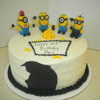 Minion Cake Chocolate cake with banana icing. The minion were sculpted out of fondant. Gru's sillouette was a sugar sheet.