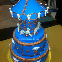 Christening Carousel Cake ! For Nicolas Cristian  If you rode a carousel when you were little, you'll remember what a magical experience it was. The thrill of the sparkling lights...
