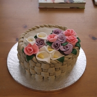 Flower Basket Cake Rosewater sponge cake covered in rosewater buttercream with buttercream and jam filling. Each piece of the basket weave is fondant and all...