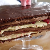 "Raspberry And Chocolate Opera Cake A recipe from the ""great british bake off"" cook book. Chocolate sponge with chocolate ganache, french buttercream, chocolate..."