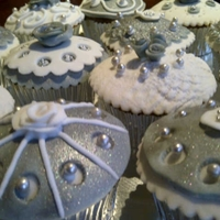 White And Silver Cupcakes Carrot cupcakes filled with white chocolate ganache.