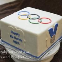 "Olympic Rings Cake 8"" square mud cake with homemade MMF decorations. Not my best fondant job - I think I rolled it too thin. I copied the ""London..."