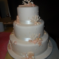 "Sea Shells Coral 3 Tier Wedding Cake   this is all handmade...12"" bottom 10"" middle 8"" top...all edible....."