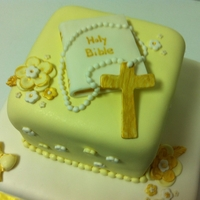 Christening Cake Pastel yellow, white, and gold accents.