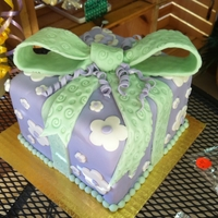 Gift Cake purple wrapped with light green bow square cake