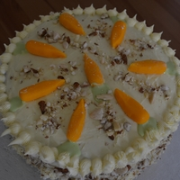 Carrot Cake topped with mini carrots fondant and crushed almonds