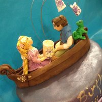 """tangled"" Cake 10"" strawberry cake with fresh strawberry and lemon filling, white chocolate ganache, and fondant. The figures and boat are all hand..."