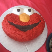 Elmo Birthday Cake Two-layered buttercream Elmo cake, with fondant-covered eyes and nose.