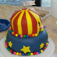 Carnival Themed Cake For Fundraiser Two-tiered cake featuring open circus tent. This was my first fondant cake! I cheated and used gumballs for added excitement, but they are...