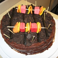 Bbq Themed Cake Simple chocolate cake made for work BBQ. Cookie wafers used for briquettes; Starburst candies used for shish kebabs, and licorice used for...