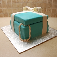 Tiffany Gift Box With Pearls Three-tiered base with lid made of cake, covered in buttercream and fondant. Bow and pearls are made of gum paste, brushed with pearl...