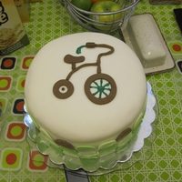 Tricycle Cake Four-tiered lemon cake with buttercream and fondant. Made for my expectant friend whose husband manages a bike shop.