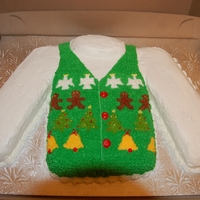 Ugly Christmas Sweater Cake Made for an Ugly Christmas Sweater themed work party. Cake is vanilla and chocolate with buttercream and pudding centre. Shapes on the x-...