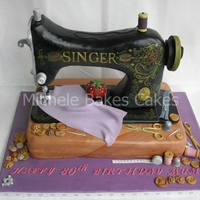 Vintage Sewing Machine  The cake is the base of the machine, the sewing machine is made from a dummy cake drum shaped and covered in sugarpaste. All the...