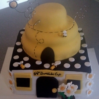 Bumblebee Cafe This is a chocolate cake with raspberrry filling covered in fondant. I made this for my daughters 22nd birthday, she loves bumblebees! All...