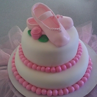 Ballerina Slippers Tiered chocolate cake with chocolate ganache filling covered in fondant. The slippers are gum paste with a little luster dust. I added the...