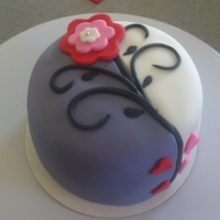 Valentines Day 5 inch red velvet cake with cream cheese filling covered in fondant. Inspiration for this cake came from the many beautiful cakes by...