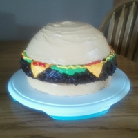 Hamburger Cake This cake was made for a vacation bible school group. The buns are yellow cake frosted in buttercream. The burger is a big brownie covered...
