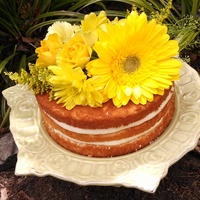 Fresh Yellow Flowers Top This Naked Cake Fresh yellow flowers top this naked cake.