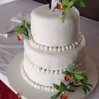 Wedding Cake With Green Orchids   Fondant-covered wedding cake with green marzipan orchids.