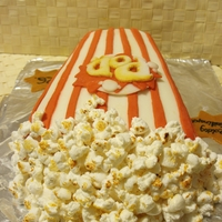 Popcorn Cake   Popcorn-themed cake covered with marshmallow fondant and marshmallow corns. The letters I have also cut by myself from a template.