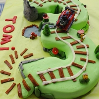 Thomas Cake For A 3 Year Old Boy Thomas Itself Is Made Of Marzipan   Thomas cake for a 3-year-old boy. Thomas itself is made of marzipan.