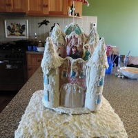 Frozen Castle Cake Base is sponge coated with butter frosting and sprinkled with coconut. Castle is made using cake dummies so that the birthday girl can keep...