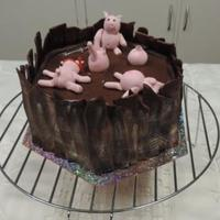 Pigs In Mud Chocolate Cake Chocolate cake filled and covered with chocolate ganache and chocolate fondant, Pigs are fondant.