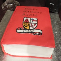78Th Birthday 'book Cake' Butter cake covered in cherry flavoured fondant. Pages features are white fondant. Coat of Arms constructed by flooded royal icing and...