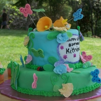 Garden Delights Cake Pastel tiers and sweet pea flowers are a inviting home for the many little critters who made their home on this 12 year old girls birthday...