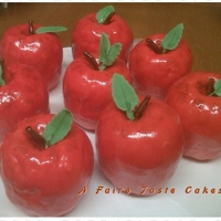 An Apple A Day Apples made from rice cereal treats, buttercream and fondant, had painted with gel food color and vodka. Loved by the kids