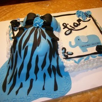 Baby Boy Vanilla Cake with Buttercream frosting.. Fondant dress and decorations