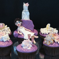 Glam Cupcakes For Bachelorette Party Vanilla bean cupcakes filled with strawberry meringue buttercream. All cake toppers are handcrafted fondant or gumpaste embellished with...