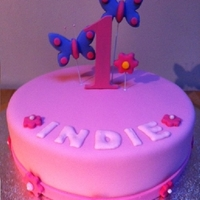 Girls 1St Birthday Cake pink fondant cake with daisies and wired butterflies