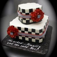 Checkboard Engagement Celebration 240 small black and white squares created this checkboard pattern on this engagement cake. Fantasy flowers were made out of sugarpaste and...