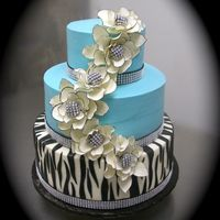 16Th Birthday Party Cake This young lady knew exactly what she wanted for her birthday cake.....zebra stripes, bling, turquoise, and fantasy flowers.