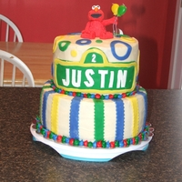 Justin's Elmo Cake I made the elmo out of fondant and gum paste. The cake is covered in buttercream and decorated with fondant decorations.
