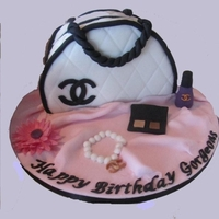 Chanel Handbag   Chocolate Sponge cake with Chocolate buttercream filling . Only my 2nd bag. Made this for a friends sister.