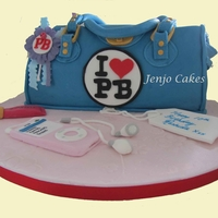 Paul;s Boutique Bag   light vanilla sponge filled with vanilla buttercream & raspberry jam. Ipod , tag & lipgloss made from fondant
