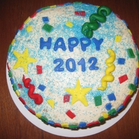 New Year's Cake Eggnog cake with rum buttercream frosting. Confetti and streamers made out of marshmallow fondant