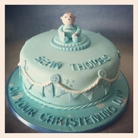 Christening Cake Christening cake topped with fondant baby in Manchester City babygro