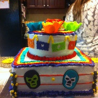 Fiesta Cake I made this for a housewarming/6 year old birthday party. It was a Mexican themed/ Mexican Wrestling Cake. I made the masks out of royal...