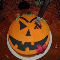 Jack-O-Lantern I made a crazy looking jack-o-lantern cake for our Halloween party.