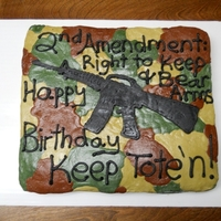 2Nd Amendment Cake   A 'guy' cake ordered by a man who works with my dad. Camo & a gun. Can't rightly get any more manly than that :)