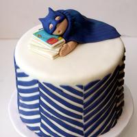 Batman And Books Themed Baby Shower White cake with vanilla buttercream. Fondant/modeling chocolate decorations.
