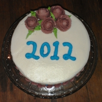 New Year 2012 yellow spice cake with butter-rum filling and vanilla frosting.