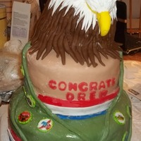 Eagle Scout Graduate Cake This cake is the colors of the scout uniform with the young man's badges on the sash. The eagle is carved.